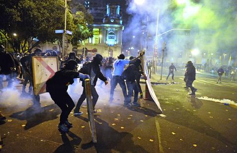 "Demonstrators clash with the police during the ""Teachers' day"" protest in demand of better working conditions and against police violence, on October 15, 2013 in Rio de Janeiro, Brazil."