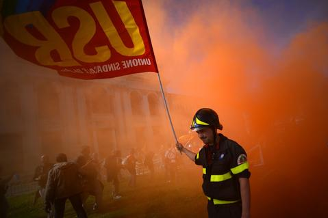 Firemen take part in a demonstration of Italian trade unions Cobas and Usb against austerity measures and European politics. Thousands of people protested against economic austerity in Rome today as partial transport strikes across the country cancelled dozens of flights and snarled buses and trains.