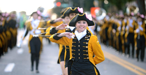 Majorette Dana Morgan, sophomore, marches with the Freedom High School Marching Band. The Allentown Halloween Parade took place Sunday afternoon. Thousands lined the parade route which started at the Allentown Fairgrounds and ended at 10th and Hamilton Streets.