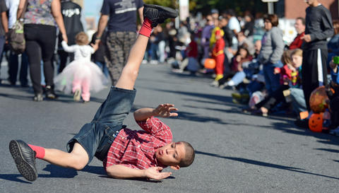 Alexander Hernandez of Allentown break dances on Hamilton Street while in the parade with Hala, the Hispanic American League of Artists. The Allentown Halloween Parade took place Sunday afternoon. Thousands lined the parade route which started at the Allentown Fairgrounds and ended at 10th and Hamilton Streets.