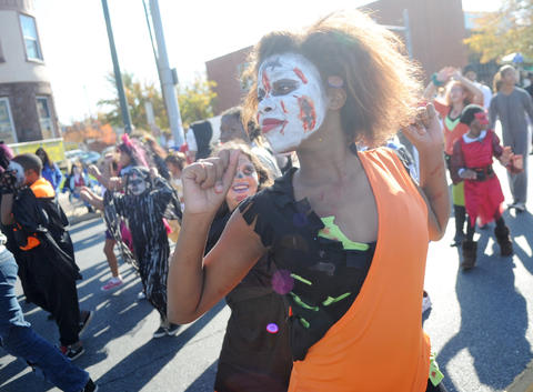 (right) Zakiyah Riley, 13, of Allentown dances with Xcape. The Allentown Halloween Parade took place Sunday afternoon. Thousands lined the parade route which started at the Allentown Fairgrounds and ended at 10th and Hamilton Streets.