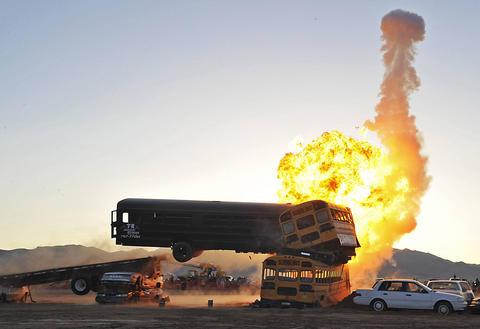 Dr. Danger attempts a school bus jump stunt in Kingman, Ariz.