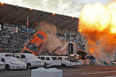 Mr. Dizzy jumps some cars at the Evergreen Speedway in Monroe, Wash.