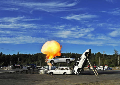 Mr. Dizzy does a crash stunt at the Evergreen Speedway in Monroe, Wash.