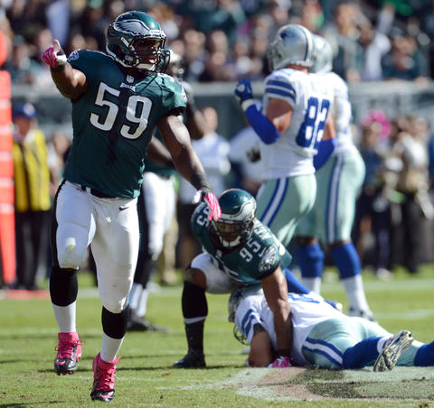 Philadelphia Eagles inside linebacker DeMeco Ryans (59) celebrates a sack against Dallas Cowboys quarterback Tony Romo (9) at Lincoln Financial Field in Philadelphia on Sunday.