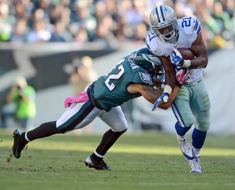 Philadelphia Eagles free safety Kurt Coleman (42) hits Dallas Cowboys running back Joseph Randle (21)  at Lincoln Financial Field in Philadelphia on Sunday.