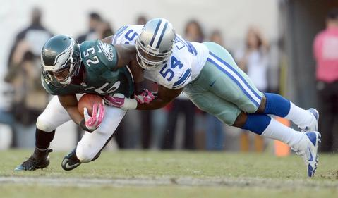 Dallas Cowboys outside linebacker Bruce Carter (54) tackles Philadelphia Eagles running back LeSean McCoy (25)  at Lincoln Financial Field in Philadelphia on Sunday.