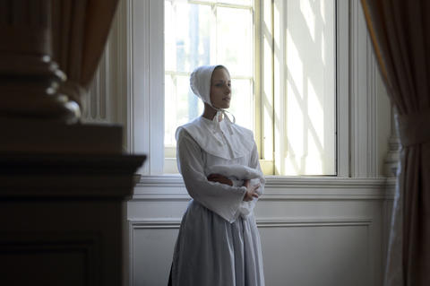 "Christine Perry, a member of the Judy Dworin Performance Project, stands in the wings during a performance of a preview of ""The Witching Hour"" at the Old State House Tuesday."