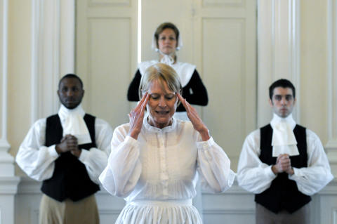 "Leslie Farlow (center) portrays Katherine Harrison, a Wethersfield woman who was tried as a witch in 1668, in a preview of ""The Witching Hour"" by the Judy Dworin Performance Project at the Old State House Tuesday. The full performance takes place Friday and Saturday, November 1 and 2 at the Wadsworth Atheneum's Aetna Theater. Ensemble members Deb Thompson (center) and Robert Byrd (left) and Jeff Short (right) perform as well."