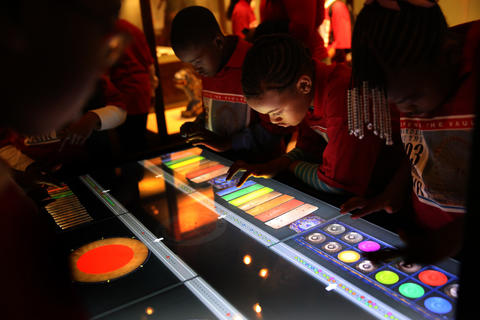 Students from Leif Ericson Elementary Scholastic Academy play an interactive electronic gamelon on that is part of an exhibit featuring different instruments that make up a gamelon from Indonesia that was on display the World's Fair.
