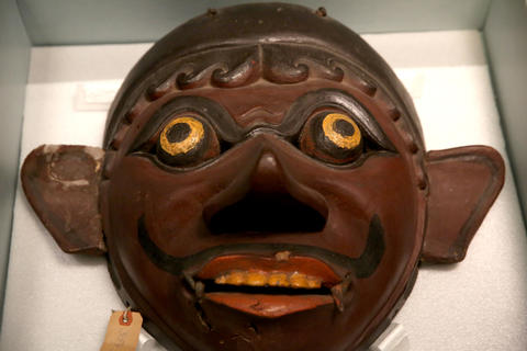 Togeng (theatrical character mask) on display in the exhibit on the 1893 World's Fair.