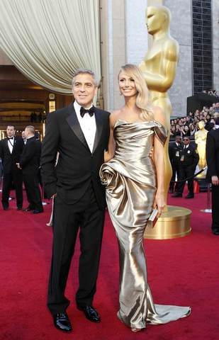 Sure, they may be broken up in real life, but that shouldn't stop you from paying homage to Baltimore native Stacy Keibler and ex-boyfriend George Clooney. Put on a glamorous dress, jewels and makeup to emulate Keibler's Hollywood style. And don't forget the best accessory: a Clooney look-alike on your arm, outfitted in a tux and salt and pepper wig.