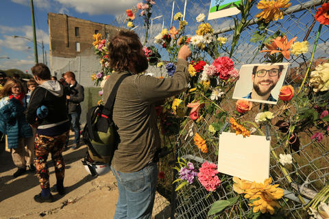 Many of Robert Cann's friends joined for a memorial gathering at the accident scene.