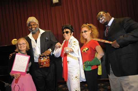 Sally Byrne, Ravens offensive lineman Michael Oher, Kevin Byrne, Emily Scerba and Ravens' Arthur Jones at the 14th Annual Goodwill Gridiron Halloween Party.