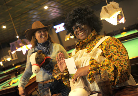 Gail Knott of Perry Hall and Mary Smith of Hanover attend the 14th Annual Goodwill Gridiron Halloween Party.