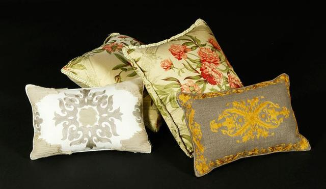 Toss a little Oprah on your sofa? These four chintz and embroidered pillows are being sold as a single lot.Estimate: $200 to $300Current high bid: $100