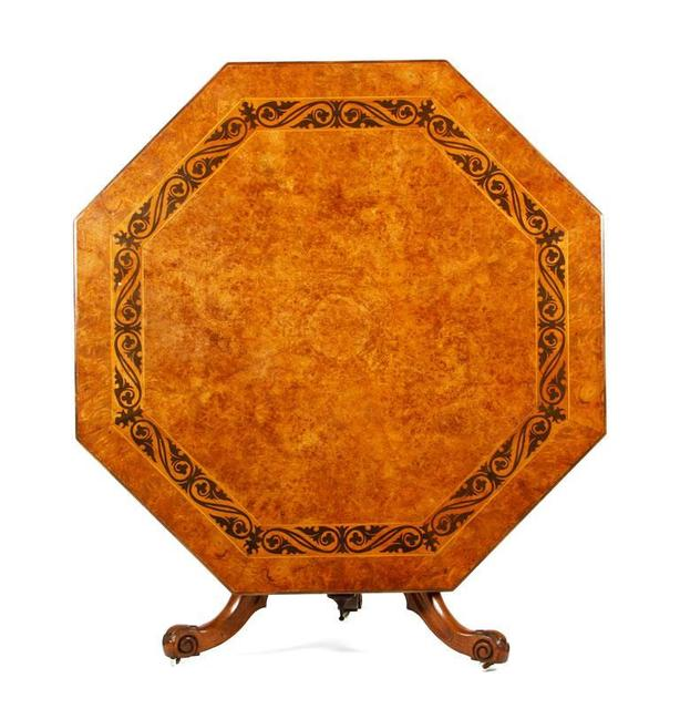 A 19th century English breakfast table has an ebony inlay. Estimate: $4,000 to $6,000 Current high bid: $2,000