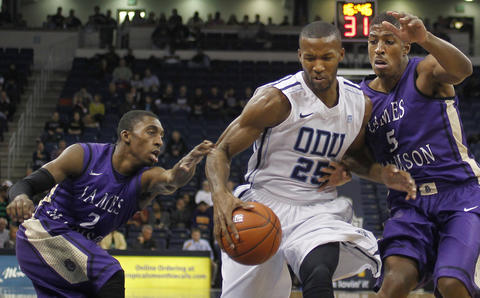 Old Dominion's Donte Hill drives past Ron Curry and Alioune Diouf during the first half of a game against James Madison on January 2.
