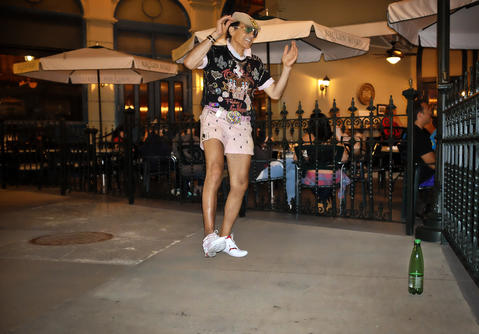 Eddy Maserati dances at Downtown Disney on October 23, 2013. Maserati dances for the exercise and loves to make people smile.