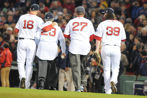 From left, Boston Red Sox third baseman Will Middlebrooks, 16, former Red Sox pitcher Louis Tiant, former Red Sox catcher, Carlton Fisk, and Boston Red Sox catcher Jarrod Saltalamacchia, 39, walk back tot he dugout after Tiant and Fisk threw out the first pitch.