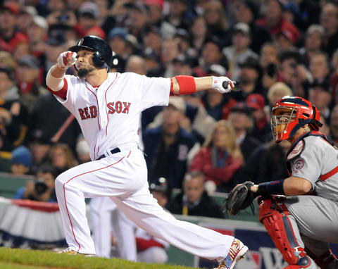Boston Red Sox right fielder Shane Victorino, 18, gets a bases loaded bases clearing base hit in the bottom of the third inning.