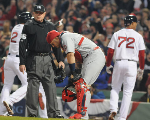 Boston Red Sox right fielder Shane Victorino, 18, hit a bases loaded bases clearing base hit in the bottom of the third inning. St. Louis Cardinals catcher Yadier Molina, 4, looks down after the third run scored.