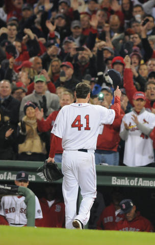 Boston Red Sox starting pitcher John Lackey, 41, tips his cap to the crowd in the top of the seventh.