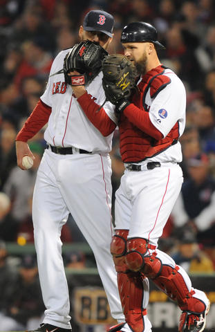 Boston Red Sox starting pitcher John Lackey, 41, talks to Boston Red Sox catcher David Ross, 3, in the top of the seventh.