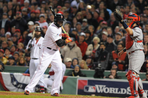 Boston Red Sox designated hitter David Ortiz, 34, is intentionally walked for the second time in the game as St. Louis Cardinals catcher Yadier Molina, 4, catches the pitch in the bottom of the eighth.