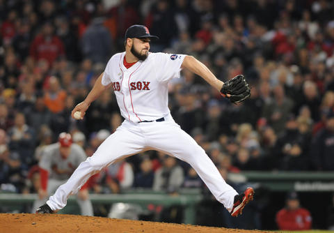 Boston Red Sox relief pitcher Brandon Workman, 67, makes a pitch in the top of the eighth.