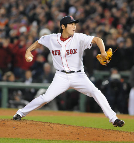 Boston Red Sox relief pitcher Koji Uehara, 19, makes the final pitch, a strikeout, in the top of the ninth.