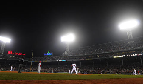 Boston Red Sox right fielder Shane Victorino, 18, takes the plate as Boston Red Sox designated hitter David Ortiz, 34, rest on third with the bases loaded in the bottom of the fourth inning. Victorino singled Ortiz home.