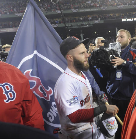 Boston Red Sox second baseman Dustin Pedroia, 15, walks on the field with a Boston Strong pennant after the victory.