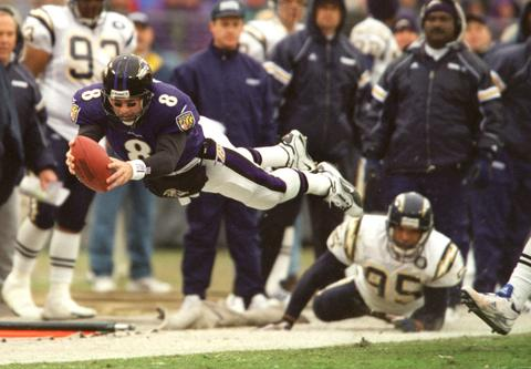 Trent Dilfer and the Ravens thoroughly outplayed Ryan Leaf and San Diego, rolling to their fifth straight win and clinching a playoff berth for the first time.