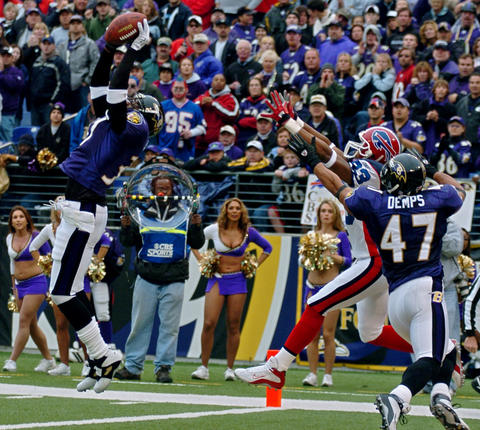 The Ravens intercepted four passes, including a high-stepping, 48-yard runback for a score by Deion Sanders.