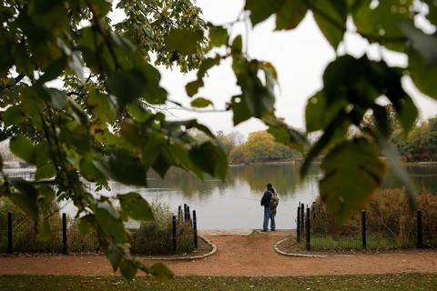 Hermann Cortes fishes at the lake at Humboldt Park near Luis Munoz Marin Drive in Chicago. Cortes said he and his friends fish at the lake every day if they can.