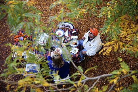 Chicago Bears fans tailgate amid fall foliage before the game against New York.