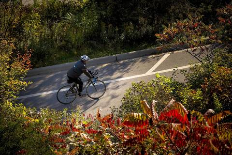 A bicyclist rides through Lakefront Beach Park in Glencoe.