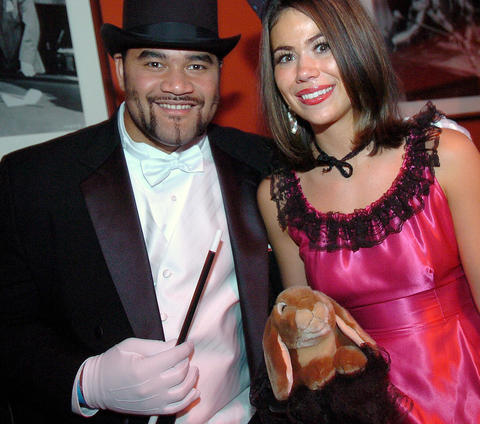 Defensive lineman Haloti Ngata and fiancee Christina Adams dressed as a magician and his assistant at a Halloween party in 2006.