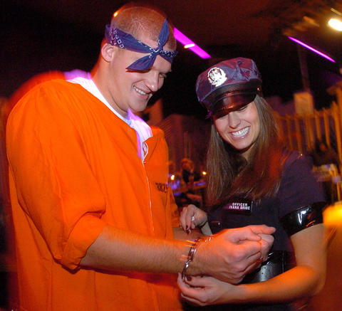 Long snapper Matt Katula and his wife Allison dressed as a convict and arresting officer in 2006.