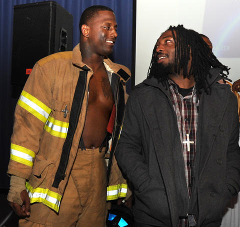 Linebacker Prescott Burgess (left) and running back Damien Berry are pictured at a Halloween party in 2011.