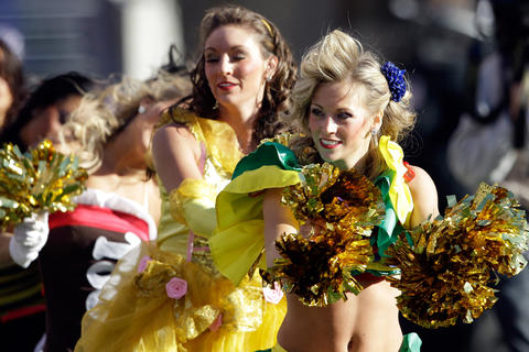 Cheerleaders perform in costume during a late October game against the Cardinals in 2011.