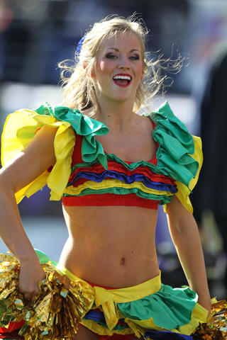 A cheerleader performs in costume during a late October game against the Cardinals in 2011.