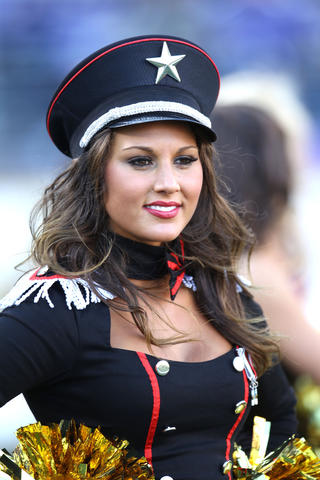 A cheerleaders performs in costume during a late October game against the Cardinals in 2011.