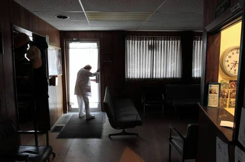 Ate 6:35 p.m., nurse Florence Bottorff locks the door at the end of a long day at the office of Dr. Russell Dohner in Rushville. The office closes at 5 p.m. but anyone still inside gets treated, so the staff often works late.