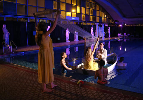 """Matt Messina and Kate Smith (in boat) perform during a dress rehearsal of Chicago Opera Theater's """"Orpheus and Euridice."""""""