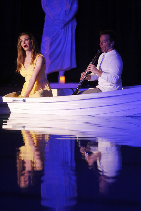 """Valerie Vinzant and Todd Palmer perform during a dress rehearsal of Chicago Opera Theater's """"Orpheus and Euridice"""" in the pool at Eckhart Park."""