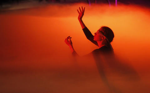 """Mist fills the pool during a dress rehearsal of Chicago Opera Theater's """"Orpheus and Euridice"""" in the pool at Eckhart Park."""