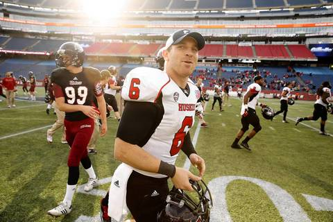 Northern Illinois quarterback Jordan Lynch heads off the field after defeating Massachusetts 63-19.