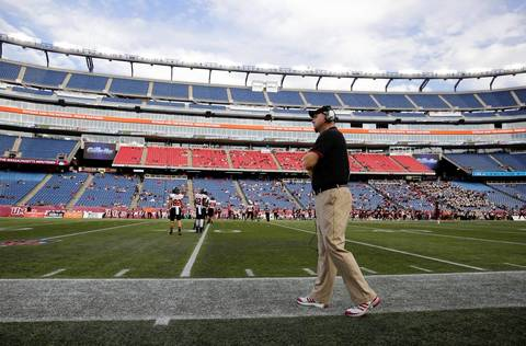 Northern Illinois coach Rod Carey watches from the sidelines at Gillette Stadium.